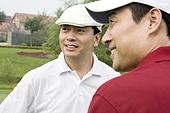 Portrait of two male golfers