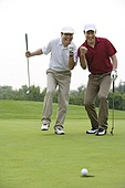 Two Golfers Celebrate a nice putt