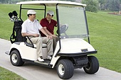 Two Golfers in the golf cart