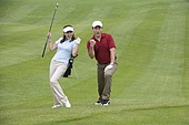 Two Golfers Celebrating a Great Shot