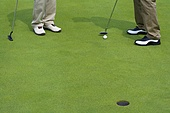 Close-up of two golfers