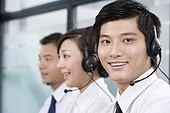Office workers with headsets