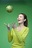 Woman in green throwing a melon