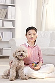 Cute girl playing with Toy Poodle
