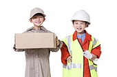 Boy and girl dressing up like delivery person and engineer