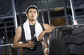 Young man resting at gym
