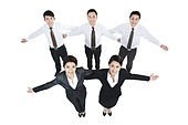 Happy business persons arms outstretched