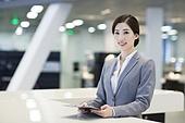 Confident receptionist at reception counter