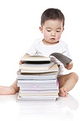 Adorable baby boy with books