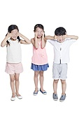 Happy children covering eyes with hands