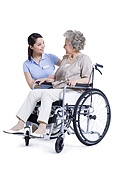 Female nursing assistant taking care of senior in wheelchair