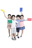 Happy children with colorful paper