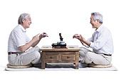 Male senior friends chatting over tea
