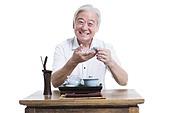 Happy senior man having tea
