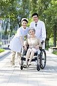 Doctor, nurse and wheelchair bound patient