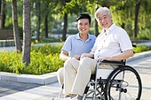 Wheelchair bound man with nursing assistant