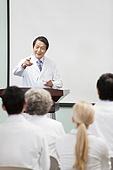 Senior doctor giving speech in boardroom