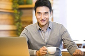 Young man drinking coffee in coffee shop