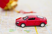 Toy car and Chinese lantern on road map
