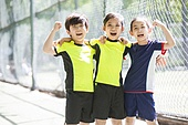 Happy children in sportswear cheering