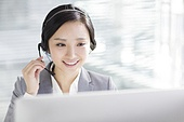 Businesswoman working in office with headset