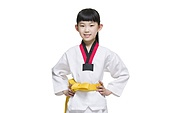 Cute girl practicing Tae Kwon Do