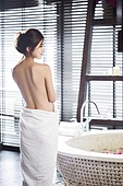 Rear view of beautiful young woman wrapped in towel