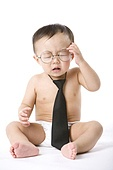 Infant with glasses and tie