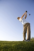 Golfer teeing off on the course