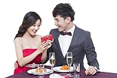 Romantic young couple dating in restaurant