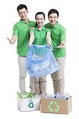 Happy volunteers recycling