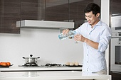Man pouring a glass of water