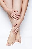 Woman Touching Her Leg