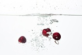 Cherries Splashing into Water