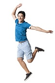 Young man jumping in mid-air