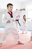 Little children practicing Tae Kwon Do