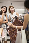 Best female friends shopping in clothing store