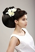 Charisma. Profile of Independent Woman with Futuristic Hairstyle and Orchid Flowers