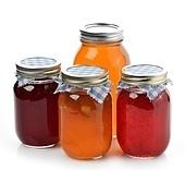 Homemade Marmalade,Jam And Honey In Glass Jars