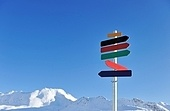 Arrow sign at mountains with snow in winter, Val-d'Isere, Alps, France
