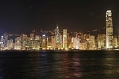 Hong Kong cityscape at night. No brand names or copyright objects.