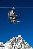 Chair-lift on background the Matterhorn; high mountain, winter ski area, Zermatt; Swiss.
