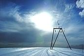 Ski-lift in back-light; high mountain, summer ski area, Zermatt; Swiss.