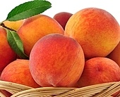 fresh peaches in a basket, close up