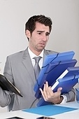 Businessman overwhelmed with work