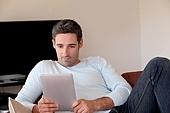 Man websurfing on internet with digital tablet