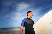 Man holding surfboard at the beach