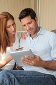 Couple doing online shopping with electronic tablet