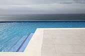 Modern swimming-pool with view towards the ocean