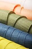 Rolls of colorful fabrics